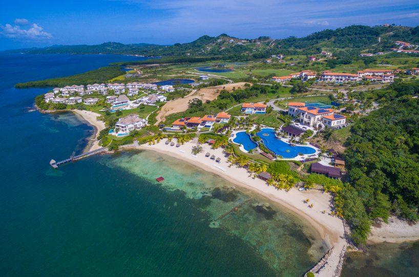 Aerial view of Pristine Bay, a high-end golf community on the island of Roatan in Honduras | Roatan Life Real Estate