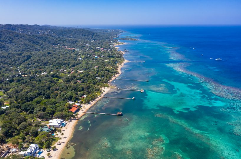 Aerial view of the north shore of Roatan island, called Sandy Bay | Roatan Life Real Estate