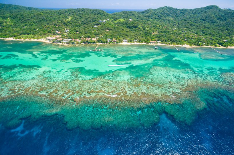 Aerial view of the reef and island of Roatan along Sandy Bay